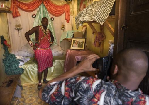 Maasai warrior making a photo souvenir in amani photo studio, Lamu county, Lamu, Kenya