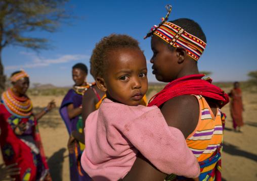 Samburu mother holding her baby, Samburu county, Samburu national reserve, Kenya