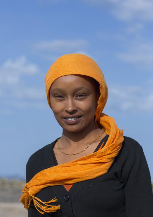 Kenyan woman with an orange scarf, Turkana lake, Loiyangalani, Kenya