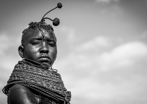 Turkana tribe woman with huge necklaces and ear rings, Turkana lake, Loiyangalani, Kenya