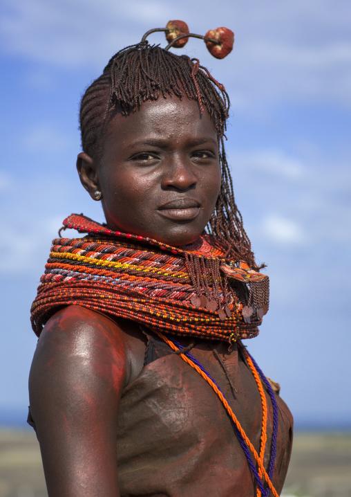 Turkana tribe woman with huge necklaces and ear rings, Turkana lake, Loiyangalani, Kenya