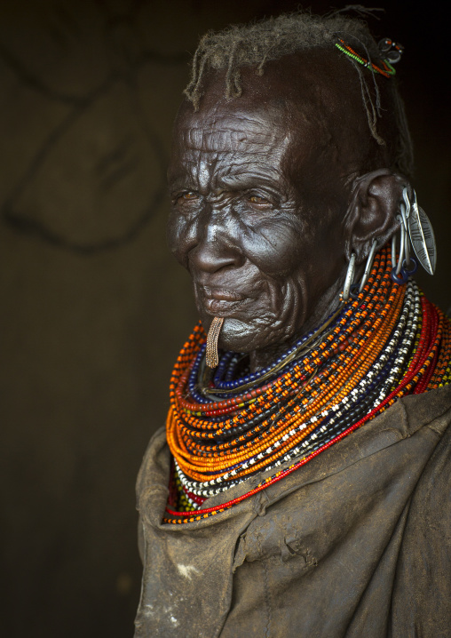 Old turkana tribe woman with huge necklaces and earrings, Turkana lake, Loiyangalani, Kenya
