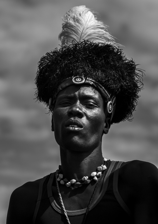 Turkana tribesman with headwear made of ostrich black feathers, Turkana lake, Loiyangalani, Kenya