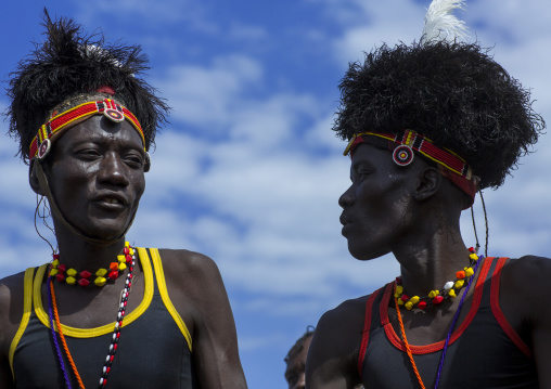 Turkana tribesmen with headwears made of ostrich blackfeathers, Turkana lake, Loiyangalani, Kenya