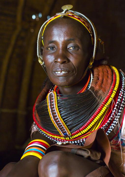 Rendille tribeswoman wearing traditional headdress and mpooro engorio necklace, Turkana lake, Loiyangalani, Kenya