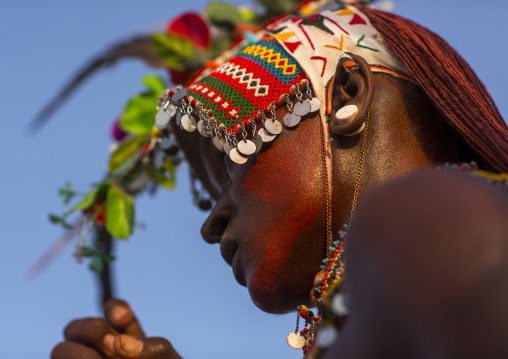 Portrait of rendille warrior wearing traditional headwear, Turkana lake, Loiyangalani, Kenya