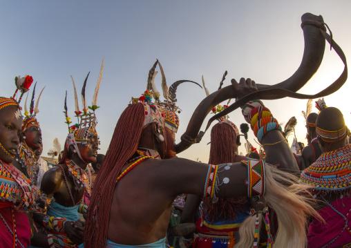 Rendille tribe man blowing in a horn, Turkana lake, Loiyangalani, Kenya