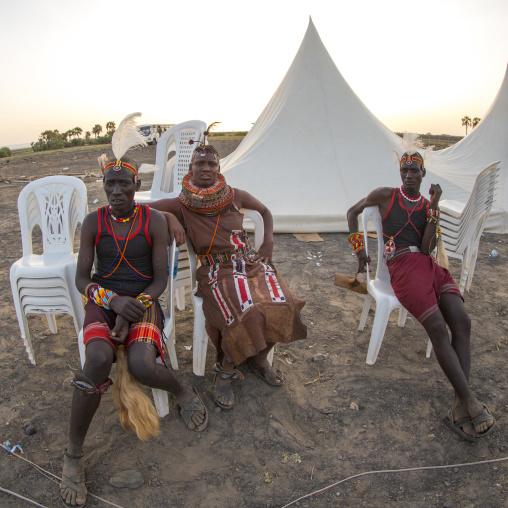 Turkana tribe people resting on plastic chairs, Turkana lake, Loiyangalani, Kenya