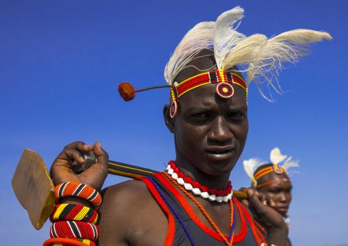 Turkana tribesman holding his wood pillow, Turkana lake, Loiyangalani, Kenya