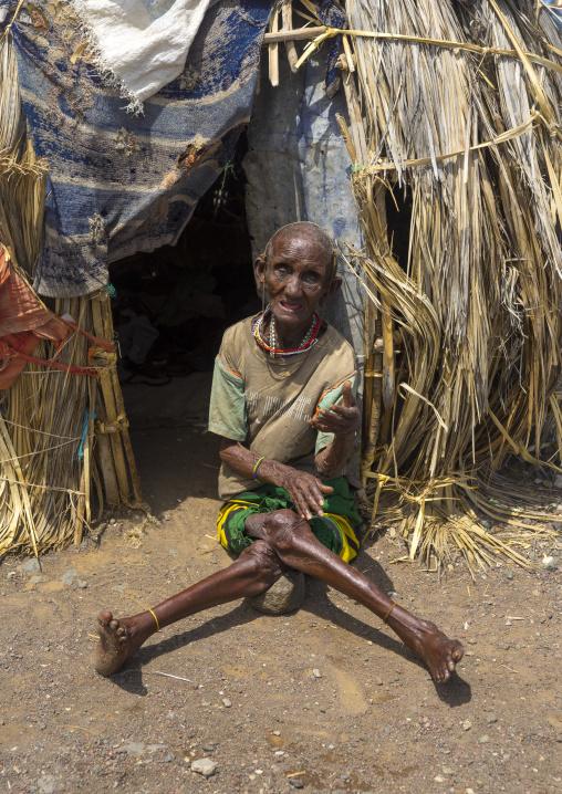 El molo handicapped tribeswoman in front of her hut, Turkana lake, Loiyangalani, Kenya