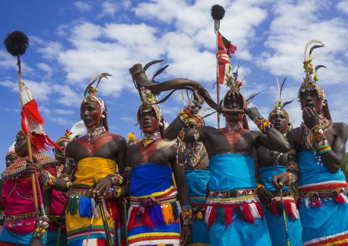 Rendille tribesmen blowing in a horn, Turkana lake, Loiyangalani, Kenya
