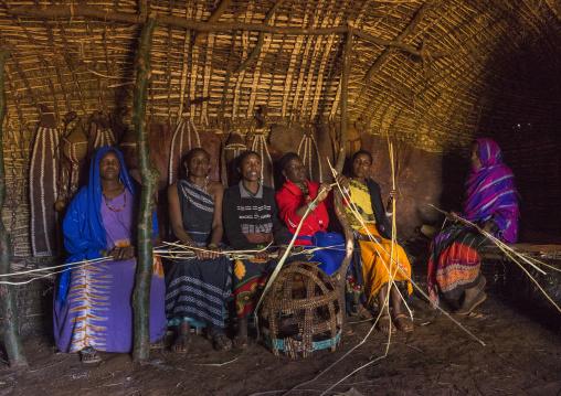 Borana tribe women inside a hut, Chalbi desert, Marsabit, Kenya