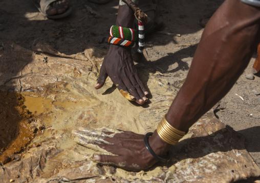 Man taking clay to use as make up in dassanech tribe, Turkana lake, Loiyangalani, Kenya