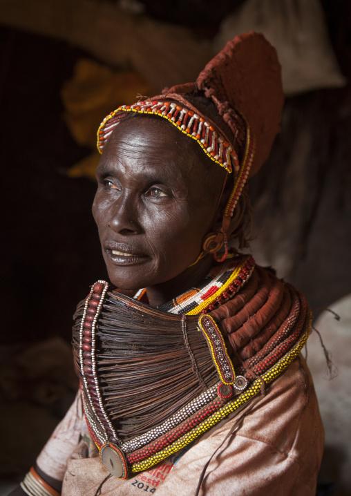 Rendille tribeswoman wearing doko headdress and mpooro engorio necklace, Turkana lake, Loiyangalani, Kenya