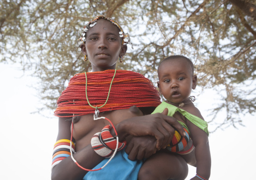 Rendille tribeswoman holding her baby, Marsabit district, Ngurunit, Kenya