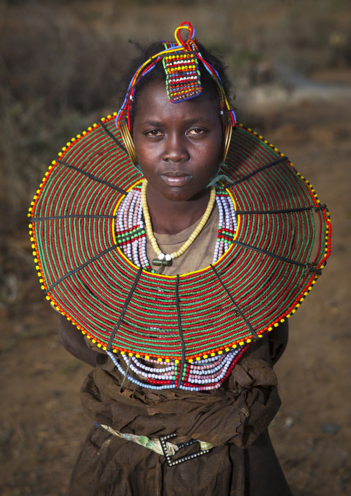 A pokot girl wears large necklaces made from the stems of sedge grass, Baringo county, Baringo, Kenya