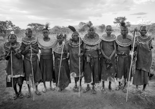 Group of pokot women wearing large necklaces made from the stems of sedge grass, Baringo county, Baringo, Kenya