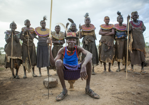 Pokot tribe people man pausing in front of the women, Baringo county, Baringo, Kenya