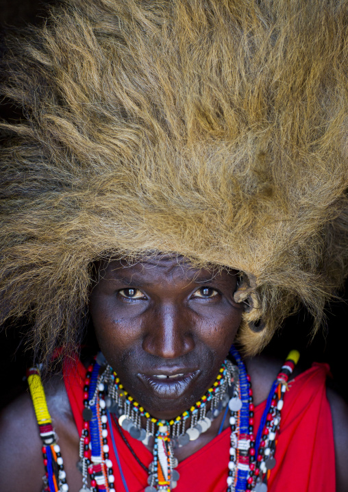 Maasai warrior with a lion hat fur on the head, Nakuru county, Nakuru, Kenya