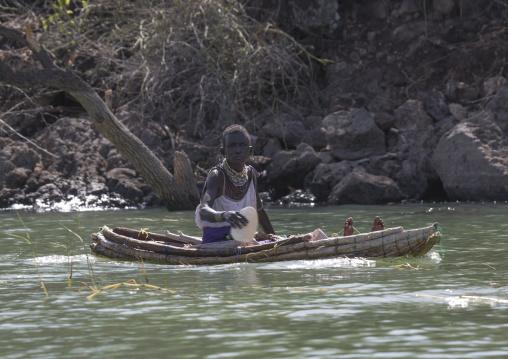 Old woman on a traditional boat rowing, Baringo county, Baringo, Kenya