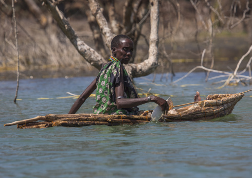 Old woman on a traditional boat rowing, Baringo county, Baringo, Kenya