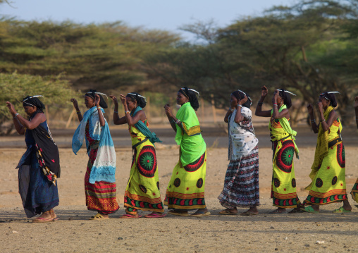 Gabra tribe women dancing in line, Marsabit County, Chalbi Desert, Kenya