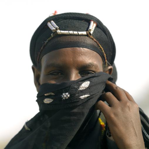 Portrait of a Gabra tribe woman with a veil hiding her face, Marsabit County, Chalbi Desert, Kenya