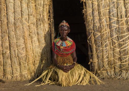 El MOlo tribe woman standing in front of her hut, Marsabit County, Loiyangalani, Kenya