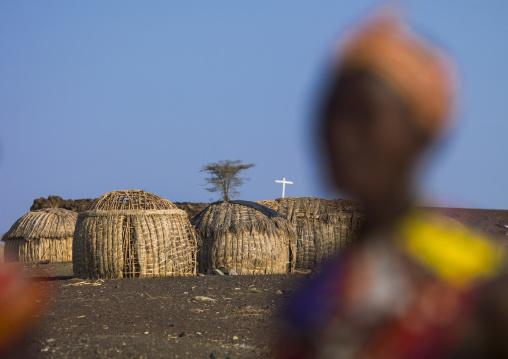 Grass huts and christian cross in el molo tribe village, Turkana lake, Loiyangalani, Kenya