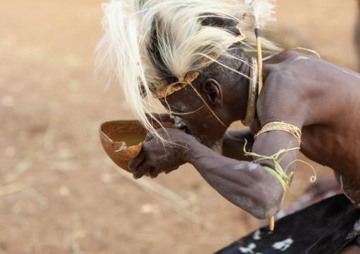 Tharaka tribe man drinking in a calabash, Laikipia County, Mount Kenya, Kenya