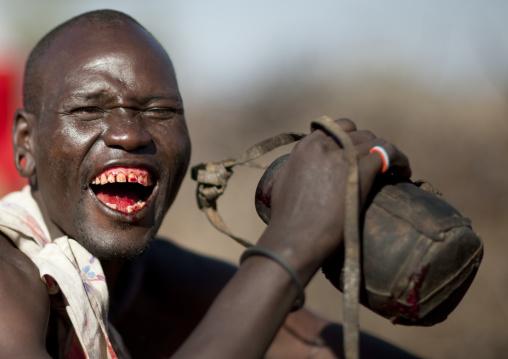 Samburu tribe man drinking cow blood, Samburu County, Maralal, Kenya