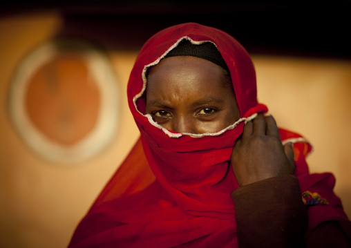 Portrait of a muslim Borana tribe woman hiding her face with a veil, Marsabit County, Marsabit, Kenya