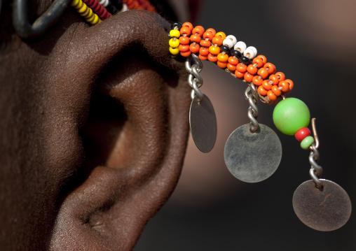 Detail of a Rendille tribe girl wearing beaded earrings, Marsabit County, Marsabit, Kenya