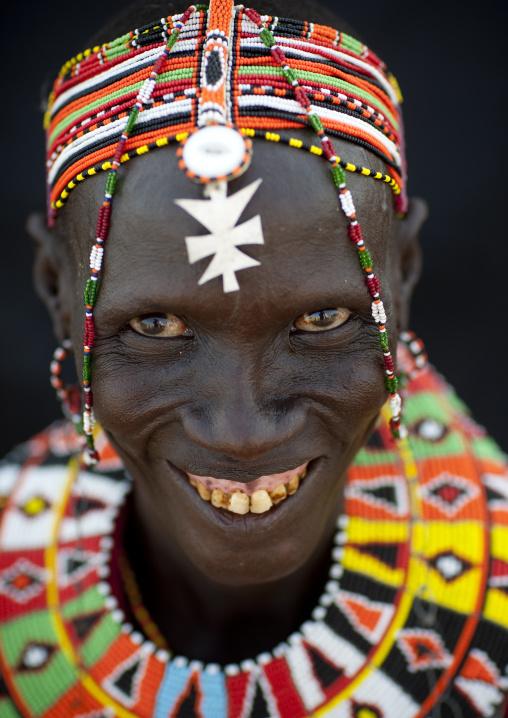 Portrait of an El Molo tribe woman with a beaded headdress, Rift Valley Province, Turkana lake, Kenya