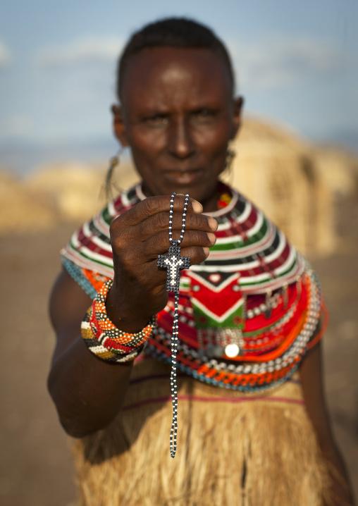 El molo tribeswoman showing a christian cross, Turkana lake, Loiyangalani, Kenya