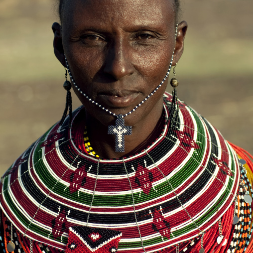 El molo tribe woman with christian cross, Turkana lake, Kenya