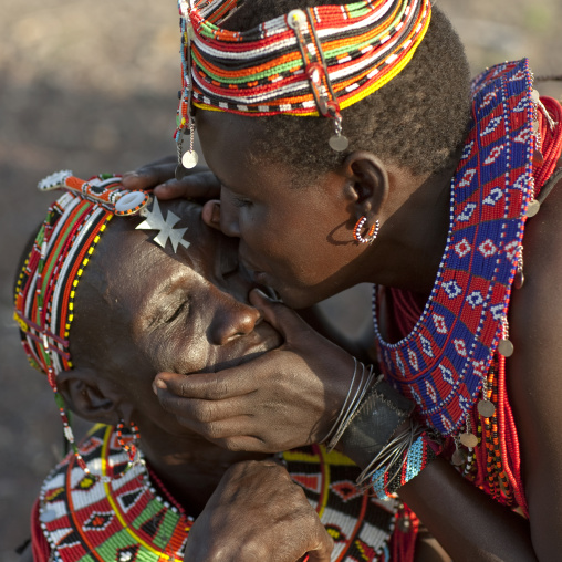 El molo tribe women cleaning their eyes from dust, Rift Valley Province, Turkana lake, Kenya