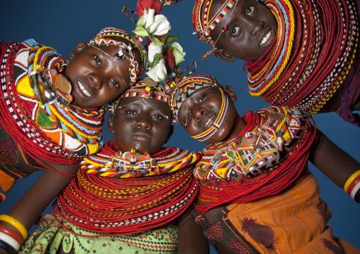 Rendille tribeswomen in circle looking down, Marsabit district, Ngurunit, Kenya