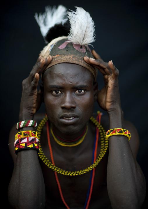 Portrait of a Turkana tribe man with a headwear, Rift Valley Province, Turkana lake, Kenya