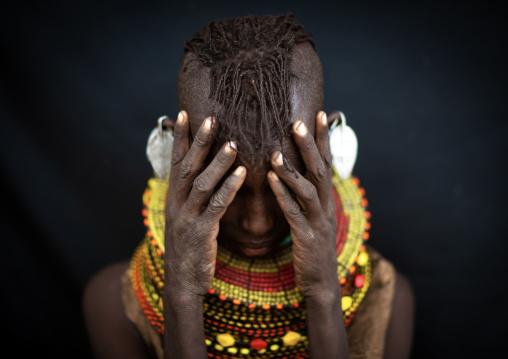 Turkana tribe woman hiding her face, Rift Valley Province, Turkana lake, Kenya