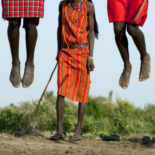 Maasai tribe men jumping during a ceremony, Rift Valley Province, Maasai Mara, Kenya