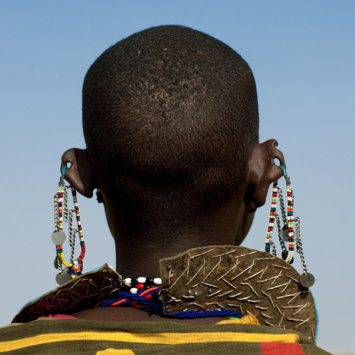 Rear view of a Maasai woman with earrings, Rift Valley Province, Maasai Mara, Kenya