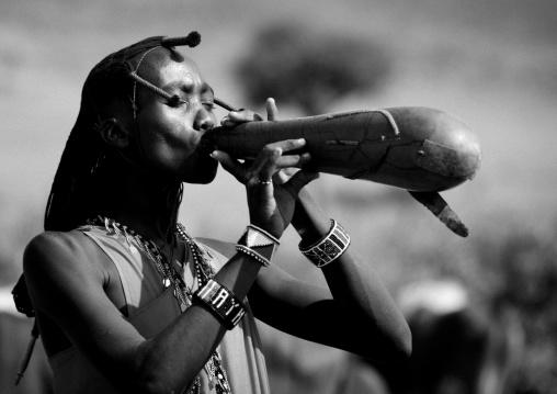 Maasai warrior drinking cow blood in a calabash, Nakuru county, Nakuru, Kenya
