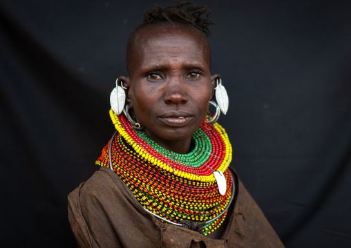 Portrait of a Turkana tribe woman with large earrings and necklaces, Rift Valley Province, Turkana lake, Kenya