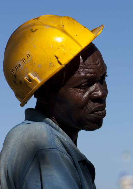 Worker wearing helmet portrait in lamu, Kenya