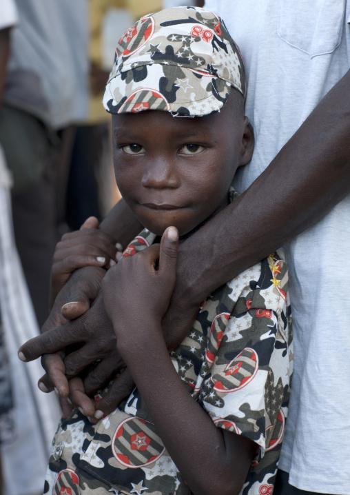 Young boy looking at camera, Lamu, Kenya