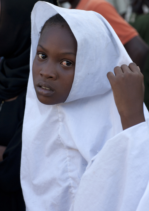 Girl in a white veil portrait, Lamu, Kenya