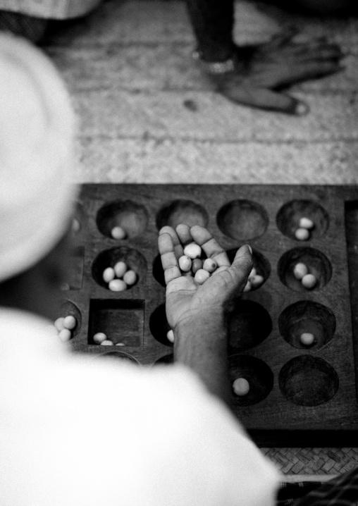 Bao player's hand during maulidi festival, Lamu, Kenya
