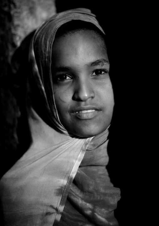 A young girl's portrait, In the half light of dusk, Lamu, Kenya