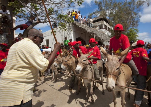 Men riding mules during maulidi donkey race, Lamu, Kenya